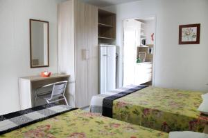A bed or beds in a room at Flats Privé Village Galés