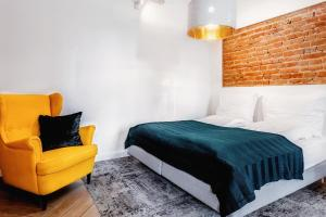 A bed or beds in a room at Apartamenty Lubartowska Street