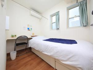 A bed or beds in a room at T House