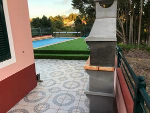 Uma vista da piscina em Paradise in Prazeres ou nas proximidades