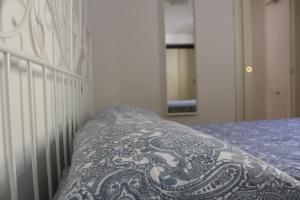 Letto o letti in una camera di Dimora Petrarca