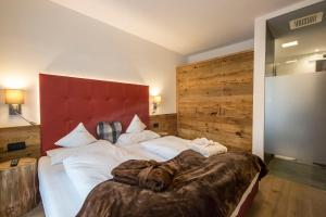 A bed or beds in a room at La Bercia Dolomites Chalet