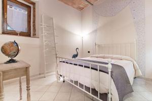 Cama o camas de una habitación en Il Nido delle Logge