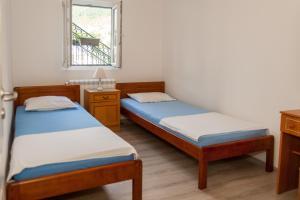 Postel nebo postele na pokoji v ubytování I&M apartments