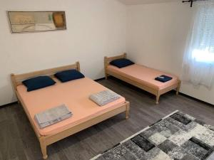 A bed or beds in a room at Apartman Grande Ajna