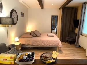A bed or beds in a room at Lovely studio heart of Le Marais