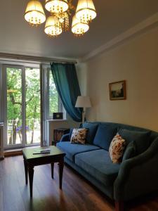A seating area at Severnaya Venezia Apartment