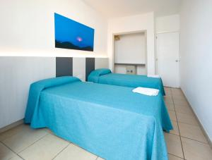 A bed or beds in a room at Apartamentos Tramuntana