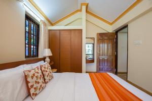A bed or beds in a room at Mistral Holidays