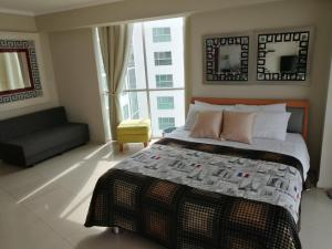 A bed or beds in a room at River View suites Puerto Santa Ana