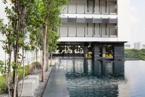 The swimming pool at or near Flexus Signature by Luxury Suites Asia