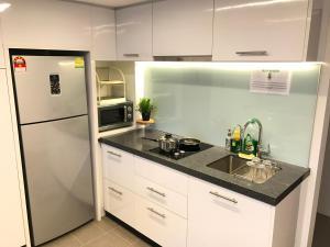 A kitchen or kitchenette at KL Bangsar Sentral PSM BY LUXURY SUITES