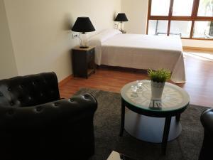 Ein Sitzbereich in der Unterkunft La Portuguesa Apartments