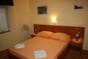 A bed or beds in a room at Apartments Villa Olga