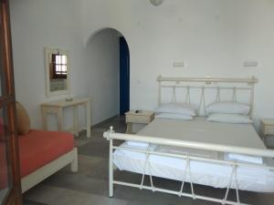 A bed or beds in a room at Nikoletta Studios