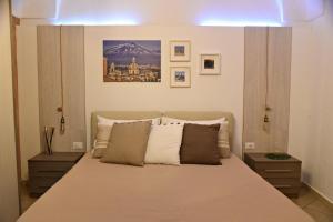 Letto o letti in una camera di Sotto il Duomo