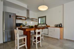 A kitchen or kitchenette at Light of Apollon