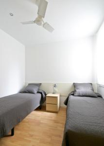 Ένα ή περισσότερα κρεβάτια σε δωμάτιο στο Weflating Eixample