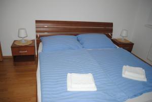 A bed or beds in a room at PIKK Trenčianske Teplice