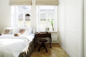 A bed or beds in a room at Old Town apartment with balcony, 7 sleeping places, 2baths