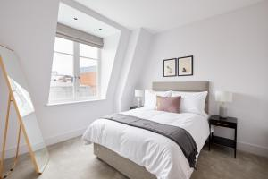 A bed or beds in a room at Sonder — The Arts Council