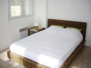 Un ou plusieurs lits dans un hébergement de l'établissement Bleu Ocean Nature