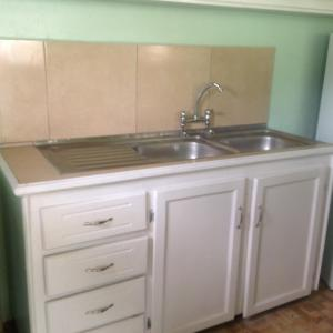 A kitchen or kitchenette at Compton House