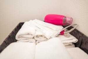 A bed or beds in a room at Dotonbori Apartment Next JR Namba