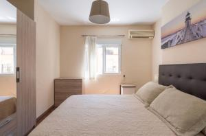 A bed or beds in a room at Apartamento Zamarrilla