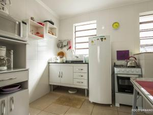 A kitchen or kitchenette at Mariano - JK pertinho de tudo!