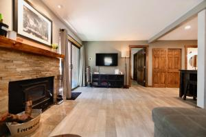 A television and/or entertainment center at Epic Mammoth Village Getaway