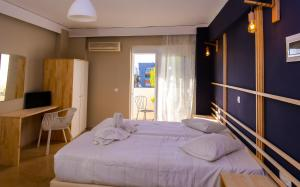 A bed or beds in a room at Lefka Hotel & Apartments