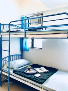 A bunk bed or bunk beds in a room at Convenient 4BR Flat In Mong Kok!
