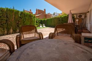 A balcony or terrace at Ground floor apartment with private garden next to puerto Banús
