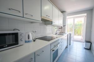 A kitchen or kitchenette at Ground floor apartment with private garden next to puerto Banús