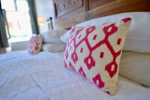 A bed or beds in a room at Casa Augustus
