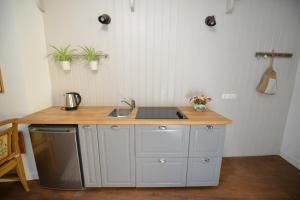 A kitchen or kitchenette at Casa Augustus