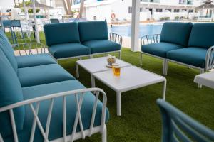 A seating area at Corralejo Surfing Colors Hotel&Apartments