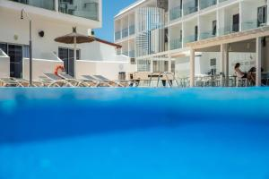 The swimming pool at or near Corralejo Surfing Colors Hotel&Apartments