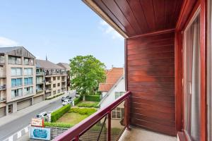A balcony or terrace at Modern & Central Apartment with free Parking