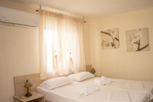A bed or beds in a room at Villa Majken