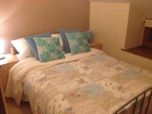 A bed or beds in a room at Ty Capel, Cefn Brith near Betws y Coed