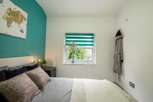 Ein Bett oder Betten in einem Zimmer der Unterkunft Smart Apartments Liverpool