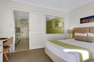 A bed or beds in a room at Quest on Story Bridge