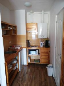 A kitchen or kitchenette at Bárka's Apartman