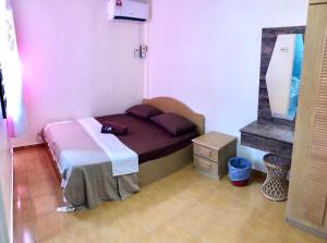 A bed or beds in a room at PD Perdana Homestay Pool side