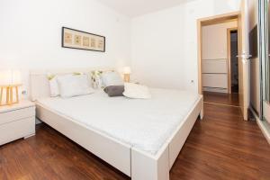 Ein Bett oder Betten in einem Zimmer der Unterkunft Apartments Musicology