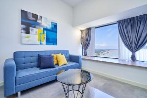 Zona de estar de OYO Home 935 Breathtaking Studio Imperio Residence