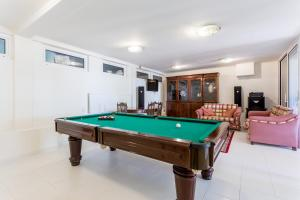 A pool table at Top Cliff Villa