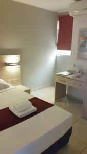 A bed or beds in a room at Luna Holiday Complex